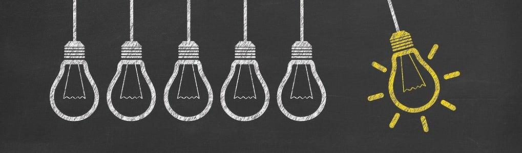 Illustrations of lightbulbs on a blackboard